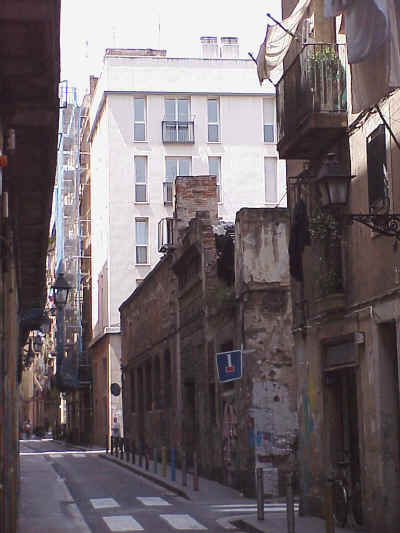 El Raval: the old and the new. A factory from the Industrial Revolution besides a new residential accommodation block
