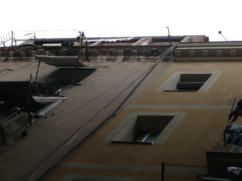Self-constructed dwellings visible on the roof tops opposite