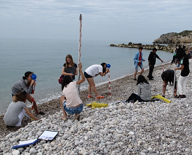 Students measuring beach profiles in Sitges